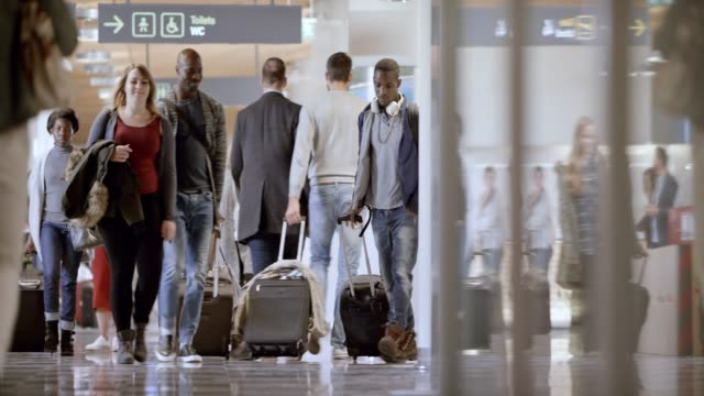 ds passengers walking in the airport terminal - wheeled luggage stock videos and b-roll footage