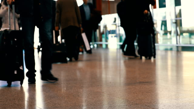 passengers walking in the airport - airport stock videos & royalty-free footage