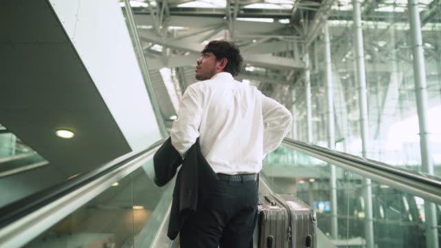 passengers walking in the glass boarding bridge - law stock videos & royalty-free footage