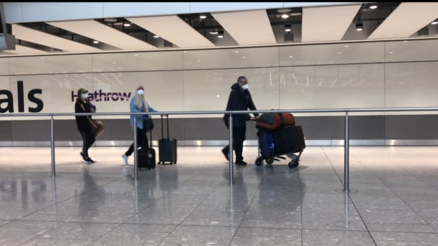 passengers walking through arrivals at heathrow airport during coronavirus lockdown - arrival stock videos & royalty-free footage