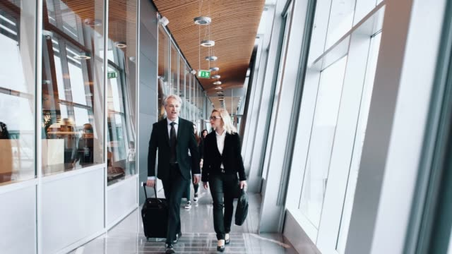 passengers walking to the gate at the airport - the way forward stock videos and b-roll footage