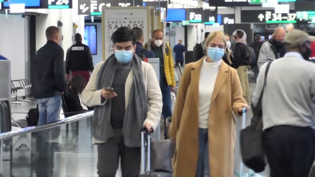 passengers wearing facemasks face shields gloves and other safety measures are seen in the airport terminal at the f gates area of vienna... - flughafen stock videos & royalty-free footage