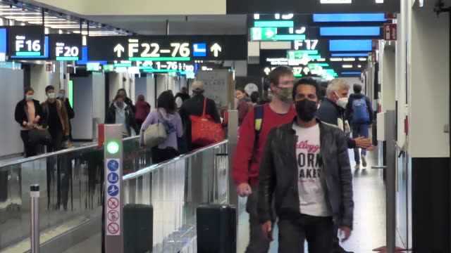 passengers wearing facemasks, face shields, gloves and other safety measures are seen in the airport terminal, at the f gates area of vienna... - austrian culture stock videos & royalty-free footage