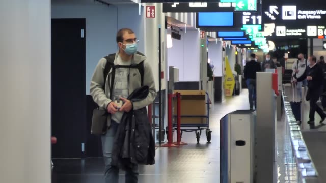 passengers wearing facemasks face shields gloves and other safety measures are seen in the airport terminal at the f gates area of vienna... - slovakia stock videos & royalty-free footage
