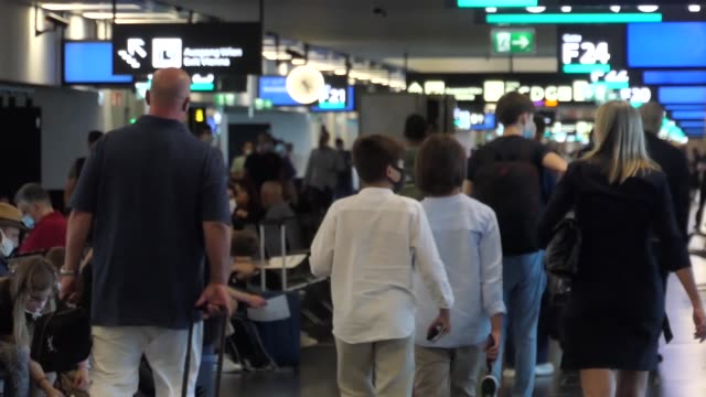passengers wearing facemasks gloves and safety measures are seen at the terminal f gates area of vienna international airport vie loww flughafen... - flughafen stock videos & royalty-free footage