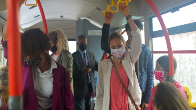 passengers wearing masks during rush hour - on the move stock videos & royalty-free footage