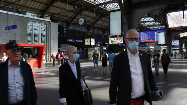 passengers wearing protective face masks walk to the tracks at zurich station during the coronavirus pandemic on july 12, 2020 in zurich,... - commercial land vehicle stock videos & royalty-free footage