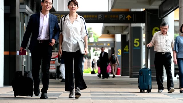 passengers with luggage walking outside airport - taipei stock videos & royalty-free footage
