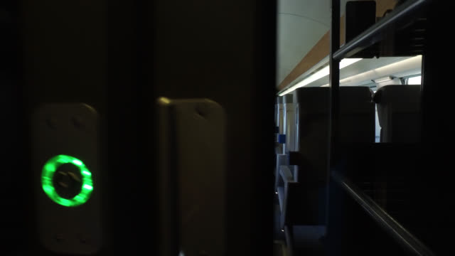 passengers with protective masks seated in a train with limited occupancy of seats due to social distancing measures tgv from paris to toulouse... - tgv点の映像素材/bロール