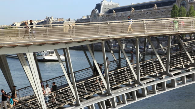passerelle leopold-sedar-senghor bridge over river seine next to musee d'orsay, paris, france - footbridge stock videos & royalty-free footage