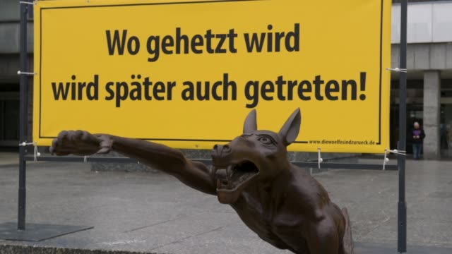 passers look at an art installation of brass wolves some giving the nazi heil hitler salute on september 13 2018 in chemnitz germany the installation... - extremism stock videos & royalty-free footage