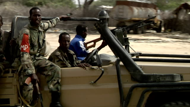 passes by village Truck with Somali militia men on July 31 2011 in Dhoobley Somalia