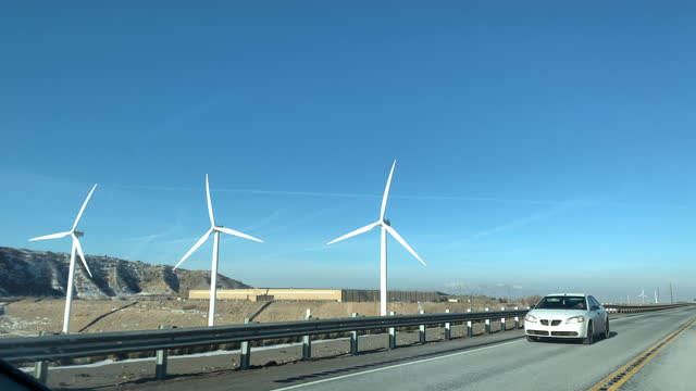 passing a wind farm on the side of the highway from the driver's point of view on highway 89 or highway 6 in the cold utah winter desert in the morning near salt lake city - provo stock videos & royalty-free footage
