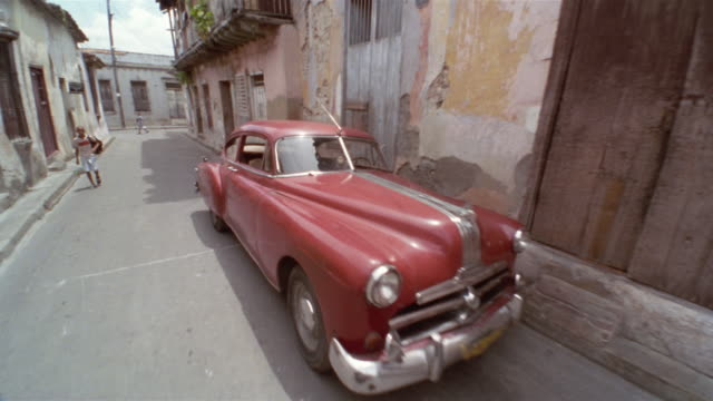 rear pov, passing abandoned vintage car parked on street, santiago de cuba, cuba  - unknown gender stock videos & royalty-free footage