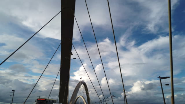 passing at famous cable-stayed bridge in brasilia. jk bridge. - cable stock videos & royalty-free footage