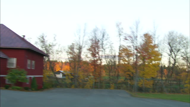 handheld passing by fields trees rural area houses homes trip tour vacation upstate travel home video countryside - augusta maine stock videos & royalty-free footage