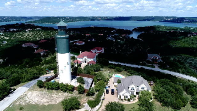 passing by lake travis light house a colorful summer paradise on the water - southwest usa stock videos and b-roll footage