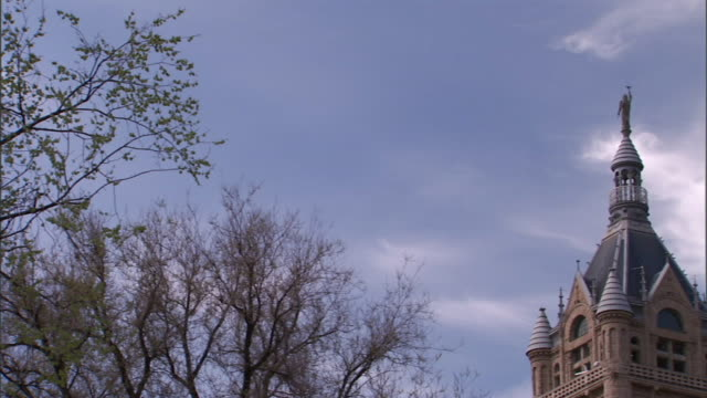 passing by plants along white stone wall, passing el castillo de san cristobal . - chiapas stock-videos und b-roll-filmmaterial