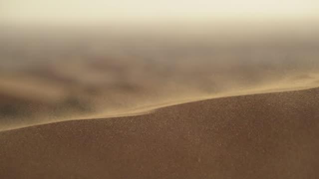 POV, passing by sand in desert
