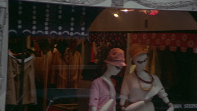 1966 side pov passing by shops and people walking on sidewalk / london, united kingdom - anno 1966 video stock e b–roll