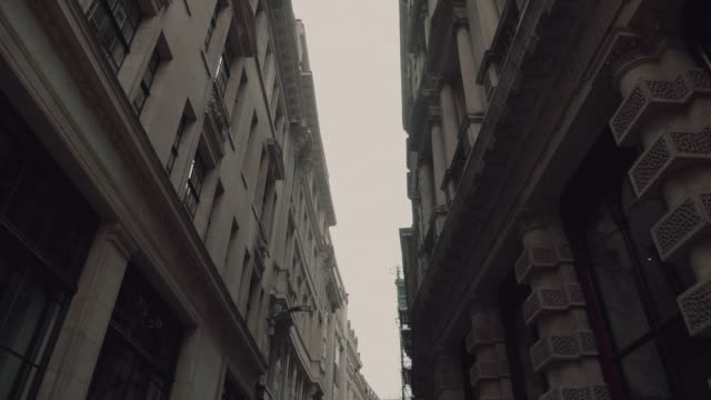 low angle view: passing by stunning skyscrapers, historic buildings - level stock videos and b-roll footage