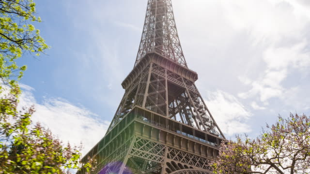 passing by the eiffel tower with a tour bus on a sightseeing tour - business finance and industry stock videos & royalty-free footage