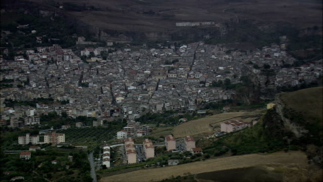 passing corleone  - aerial view - sicily, province of palermo, corleone, italy - sicily stock videos and b-roll footage