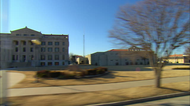 POV Passing court house and jail facility near Ponca City, Oklahoma, USA