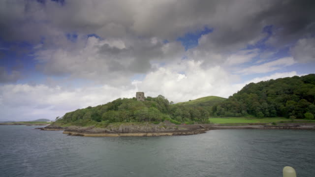 passing dunollie castle, oban, scotland, from a passenger ferry on its way to the islands - scotland stock videos & royalty-free footage