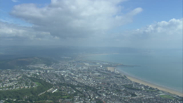passing high over swansea - wales stock videos & royalty-free footage