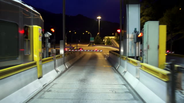 hd passing highway toll booth at night - brennero stock videos and b-roll footage