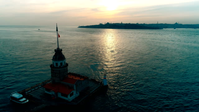 passing maiden's tower at sunset in istanbul by drone - byzantine stock videos & royalty-free footage