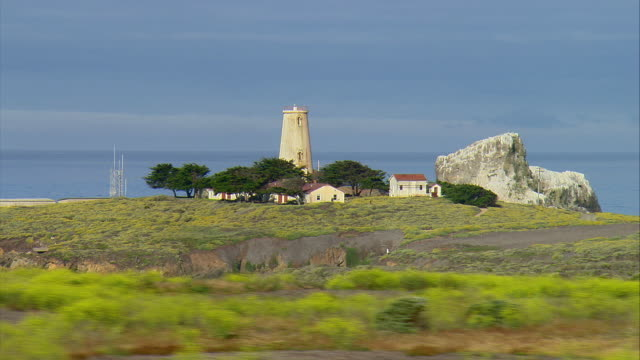 SIDE POV Passing Piedras Blancas Light Station near San Simeon, California, USA