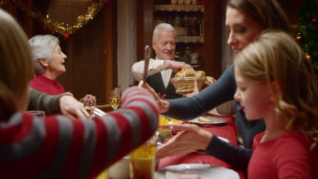 Passing the bread buns at the festive Christmas table