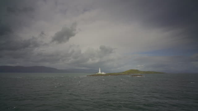 passing the eilean musdile lighthouse - ferry stock videos & royalty-free footage