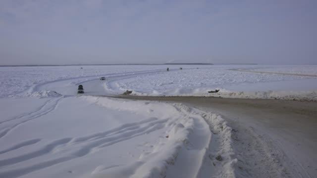 passing the frozen lena river on kolyma highway, russian far east - pavel gospodinov stock videos & royalty-free footage