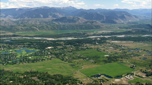 Passing the Town Of Moose Wilson Road And Wilson  - Aerial View - Wyoming,  Teton County,  helicopter filming,  aerial video,  cineflex,  establishing shot,  United States
