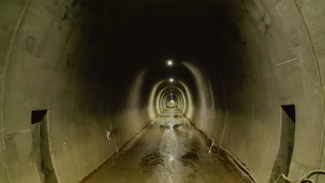 passing through an unfinished made tunnel - vanishing point stock videos & royalty-free footage