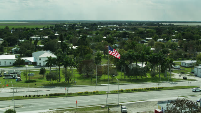u.s. 27 passing through moore haven, florida - aerial - street name sign stock videos & royalty-free footage