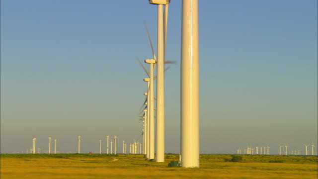 side pov, passing wind turbines on field near sweetwater, texas, usa - order stock videos & royalty-free footage