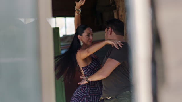 slo mo. passionate ballroom dancers perform synchronized dance routine in rustic barn setting. - bracelet stock videos and b-roll footage