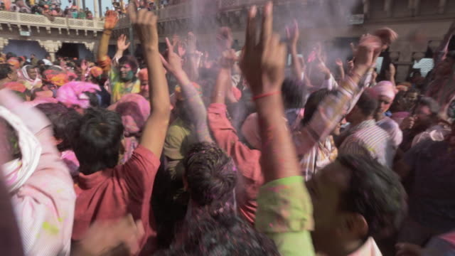 passionate, dancing crowd at holi festival, india - joy stock videos & royalty-free footage