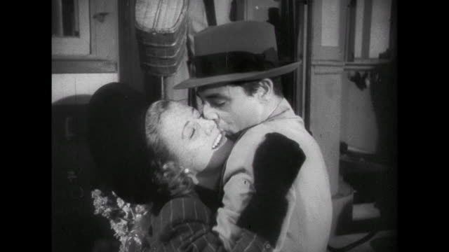 1941 passionate kisses between couple (irene dunne and cary grant) upon woman's arrival - railway station stock videos & royalty-free footage