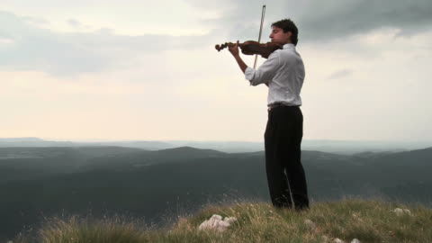 hd crane: passionately playing the violin - violin stock videos & royalty-free footage