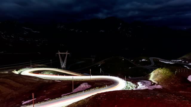 passo dello stelvio time lapse at night - mountain pass stock videos & royalty-free footage