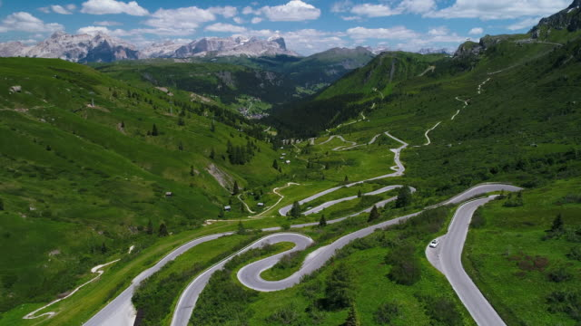 passo pordoi mountain road seen from an aerial point of view, dolomites, italy - dolomites stock videos & royalty-free footage