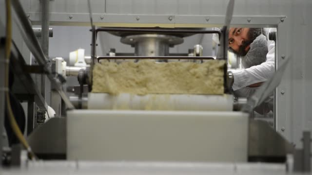 passover matzo is made at the manischewitz co factory in newark new jersey us passover matzo moves down a conveyer belt and into an oven at the... - passover stock videos and b-roll footage