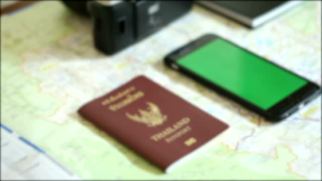 passport and smartphone on map for travel