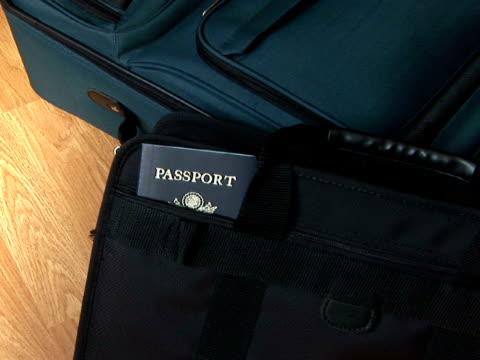 stockvideo's en b-roll-footage met cu, zi passport in suitcase pocket - zak persoonlijk accessoire