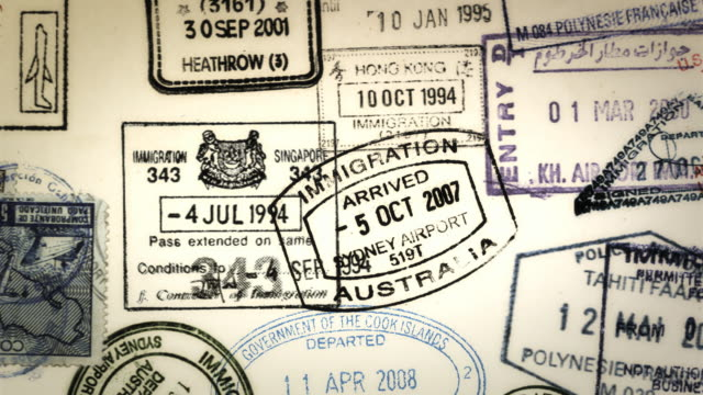 cgi, passport stamps and visas appearing in passport pages - emigration and immigration点の映像素材/bロール